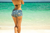 Young beautiful woman in denim shorts