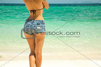 Young beautiful woman in denim shorts