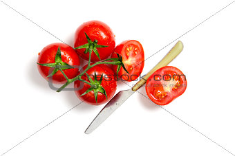 Top view of bunch of fresh tomatoes and knife