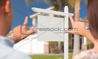 Blank Real Estate Sign, House and Military Couple Framing Hands
