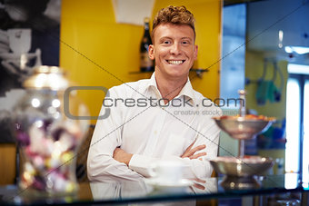 happy man working as barman smiling in bar