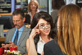 Skeptical Female in Cafe