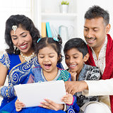 Indian family using digital computer tablet