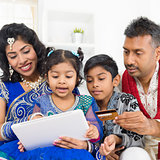Indian Asian family online shopping