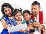 Indian Asian family online shopping with credit card