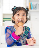 Indian girl eating ice cream.