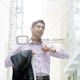 Indian businessman taking off his tie