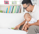 Father and baby reading story book