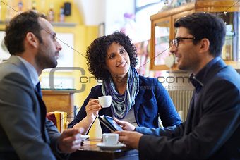 business team working in cafeteria and drinking espresso