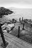 Black and white picture of steps leading down into sea and leadi