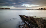 Long exposure seascape landscape during dramatic evening in Wint
