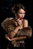 Retro. Beautiful, attractive woman wearing fur