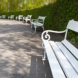 White bench in spring park on Petrin