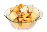 Various types of cheese in glass bowl