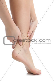 Pain concept with a woman hands catching ankle