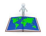 Person showing book with world map