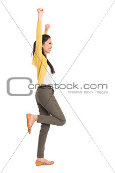 Side view Asian woman jumping