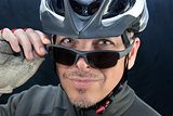 Friendly Bicycle Courier Looks Over Sunglasses