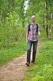 Male hiker walking in forest.