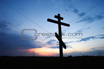 cross silhouette with the sunset