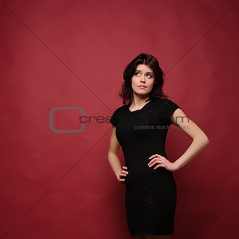 attractive young woman thinking