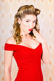 Female pin-up beauty blowing kiss of surprise