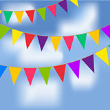 Party flags with blue sky and white clouds. Contains a gradient mesh.