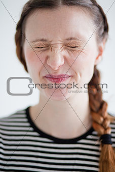 Attractive woman smirking with eyes closed