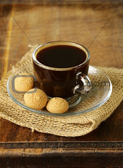 cup of black coffee with biscuits amaretti (almond cookies)