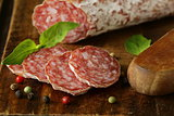 delicacy smoked sausage (salami) on a wooden board