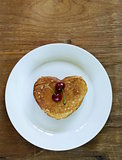 sweet dessert pancakes in the shape of a heart for breakfast