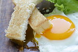 fried egg with fresh vegetables and toast for breakfast