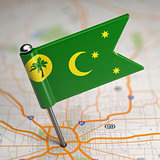 Cocos (Keeling) Islands Small Flag on a Map Background.