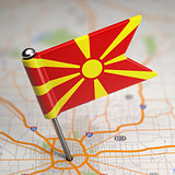 Macedonia Small Flag on a Map Background.