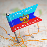 Luhansk People's Republic Small Flag on a Map Background.