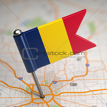 Chad Small Flag on a Map Background.
