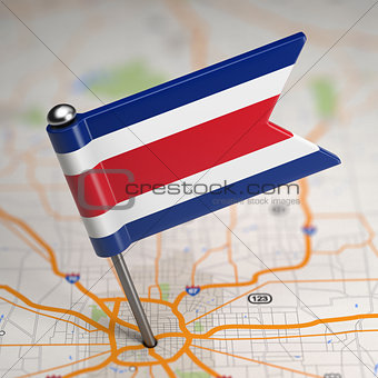 Costa Rica Small Flag on a Map Background.
