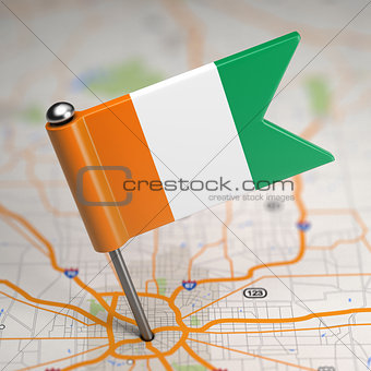 Cote d'Ivoire Small Flag on a Map Background.