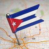 Cuba Small Flag on a Map Background.