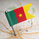 Cameroon Small Flag on a Map Background.