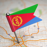 Eritrea Small Flag on a Map Background.