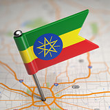 Ethiopia Small Flag on a Map Background.