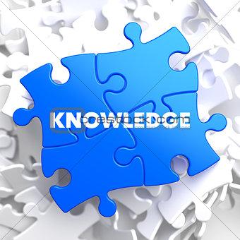 Knowledge Concept on Blue Puzzle.