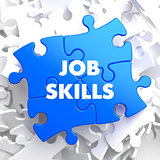 Job Skills Concept on Blue Puzzle.