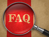 FAQ Concept Through Magnifying Glass.