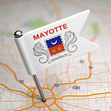 Mayotte Small Flag on a Map Background.