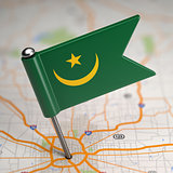 Mauritania Small Flag on a Map Background.