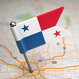 Panama Small Flag on a Map Background.