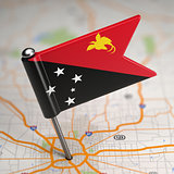 Papua New Guinea Small Flag on a Map Background.