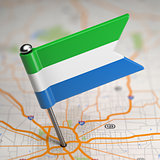 Sierra Leone Small Flag on a Map Background.
